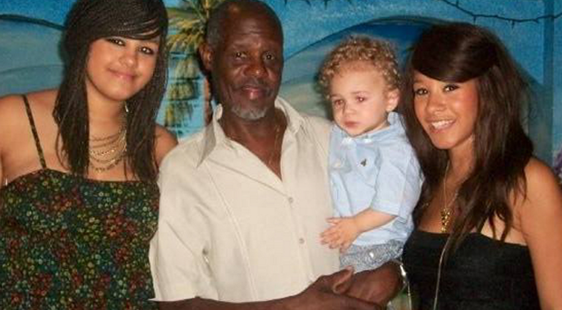 Winston Samuels with his granddaughter and daughters Joni and Tanice