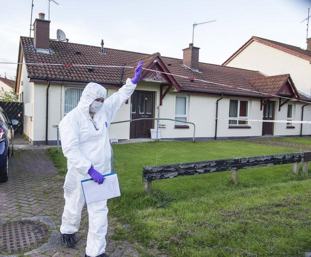 Attack: Forensics officer at the scene of the robbery in Bessbrook