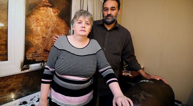Margaret and Amin Ibrahim in their home in Ballymena where a petrol bomb was thrown through the front window