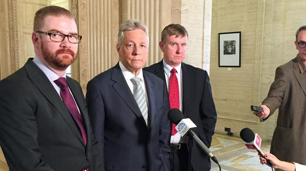 Simon Hamilton, Peter Robinson and Mervyn Storey from the Democratic Unionist Party