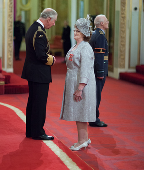 Autism NI's CEO Dr Arlene Cassidy is awarded an MBE by Prince Charles at Buckingham Palace yesterday