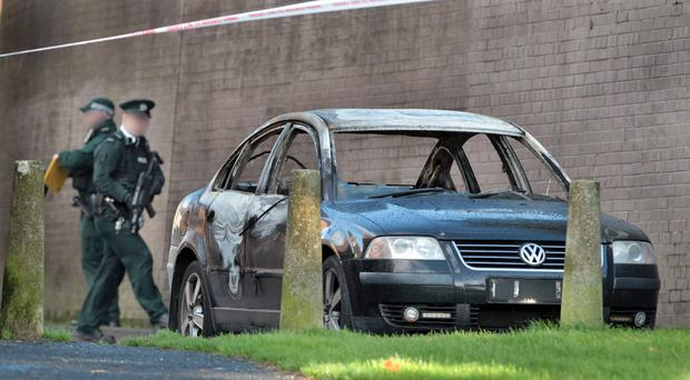 The burnt-out car being linked to the bomb alert