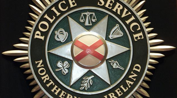 The PSNI said suspicious items found during a house search are being examined