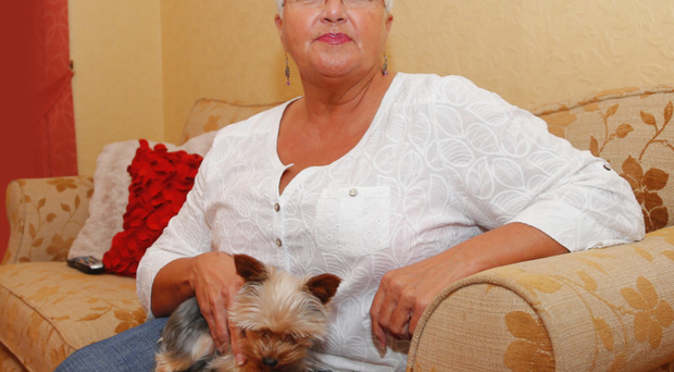 Ruth Patterson in her home with dog Paisley