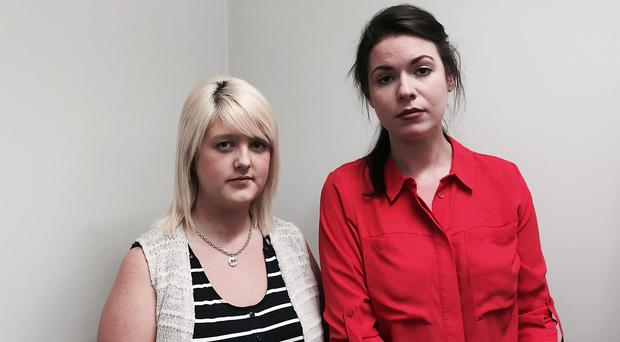 Sarah Ewart, left, who had to travel to England to have an abortion after being told her unborn baby had no chance of survival, with Grainne Teggart from Amnesty International