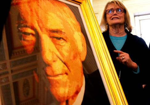 Marie Heaney with the portrait of her husband