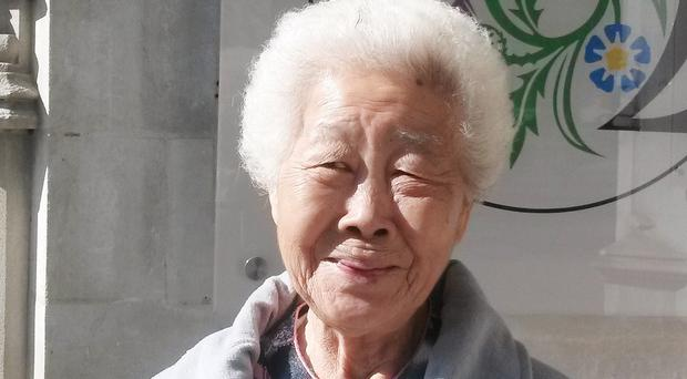 Madam Lim Ah Yin outside the UK Supreme Court in London who is a survivor of the shootings at Batang Kali