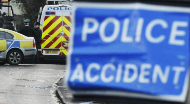 A woman in her 50s has been seriously injured and was found lying unconscious on a road in Co Down