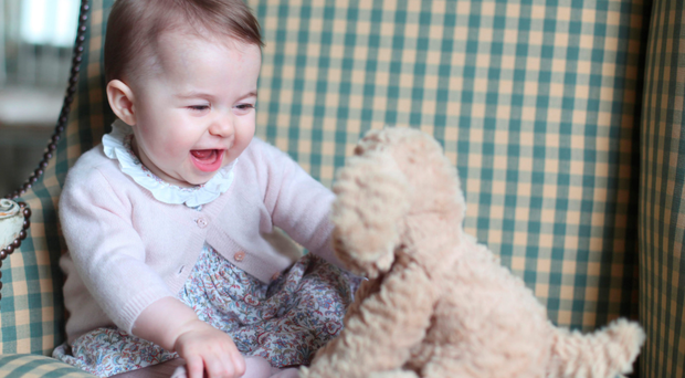 Princess Charlotte of Cambridge with a toy dog