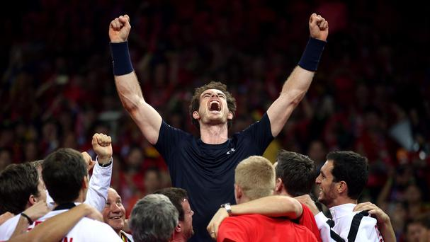 Andy Murray is mobbed by his team-mates after beating Belgium's David Goffin to win the Davis Cup
