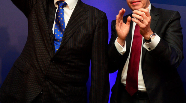Peter Robinson waves to the DUP faithful watched by Nigel Dodds at the party conference last month