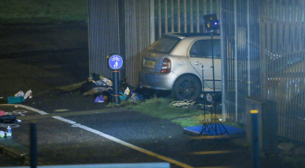 The silver car involved in the accident after it came to rest by the side of the road