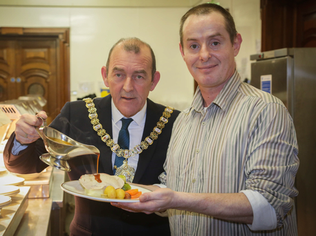 The Lord Mayor of Belfast, Arder Carson, with a resident of the Morning Star Hostel in Belfast at the City Hall last night