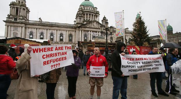 A group called the Protestant Coalition hold an anti-refugee protest in Belfast city centre