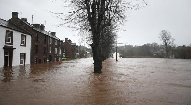 Flooded roads in Appleby in Cumbria, as Storm Desmond hit the UK