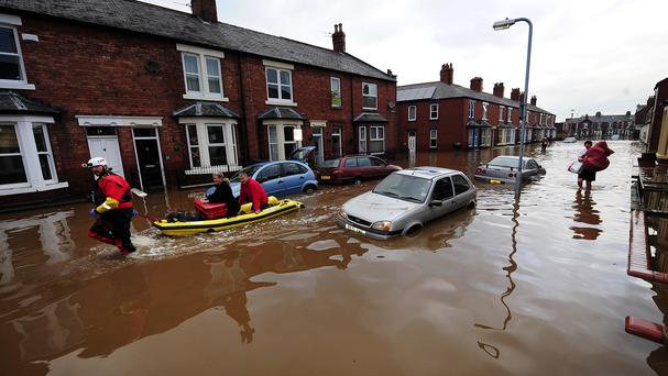 Rescue teams continue their work to bring people out of flooded homes in Carlisle