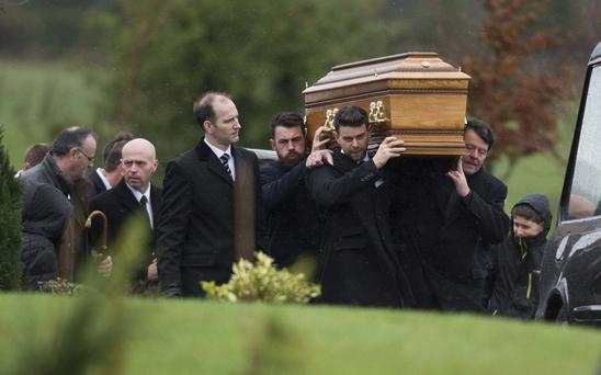 The coffin of Coleraine man Gerard Bradley, who was 29 and from Ringsend, is carried at his funeral