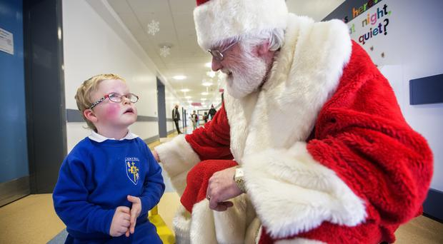 Titanic Belfast's Father Christmas visited the young patients at the Royal Belfast Hospital for Sick Children, including little Joshua Campbell from Lisburn