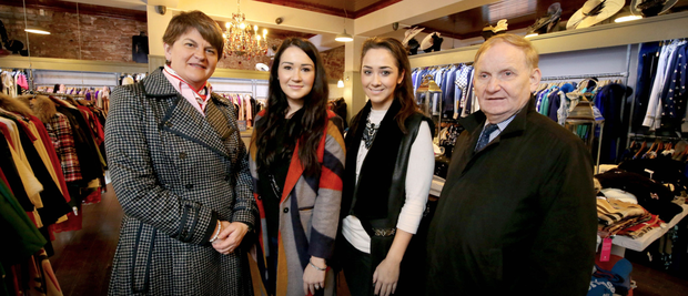 Arlene Foster and Lord Morrow speak to The Boudoir ladies' boutique proprietors Anita and Donna Ross after their store was damaged by floodwater