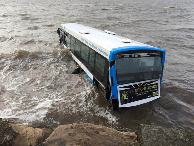 The bus on the beach after crashing on Portaferry Road, near Newtownards, before it was winched out of the tide