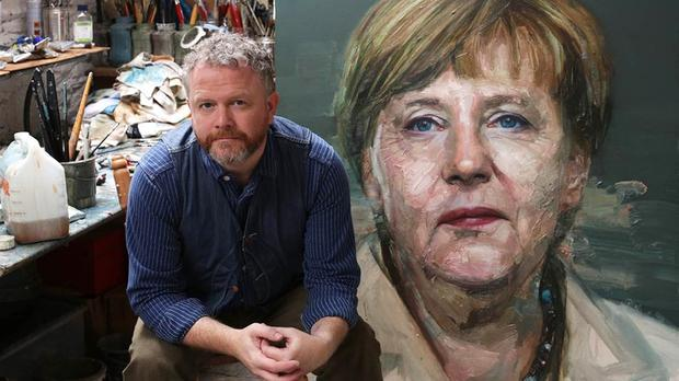 Colin Davidson with his painting of Angela Merkel which made the front cover of Time magazine (Colin Davidson/PA)