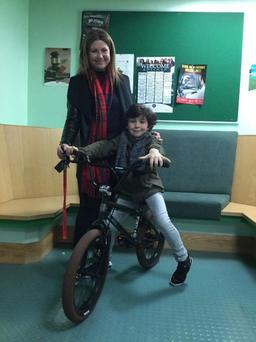 Adee and his mum Kirsty with the new bike officers bought for him