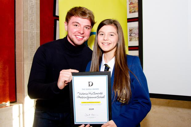 X Factor star Jordan O'Keefe presents Diana Award winner Victoria McClements with her certificate yesterday