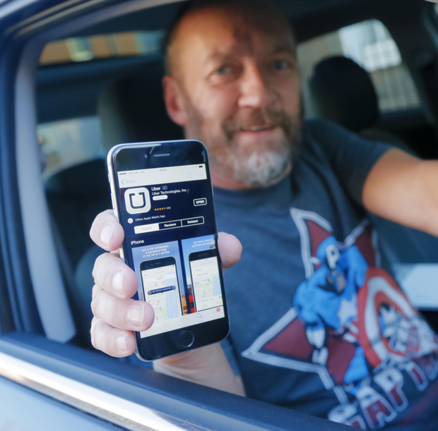 Adrian Hanna with Uber, the new taxi-booking app which launched in Belfast this year.