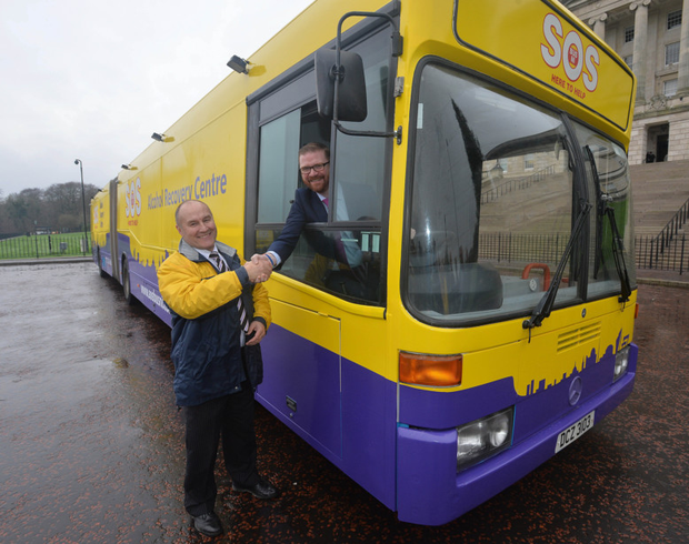 Health Minister Simon Hamilton with SOS Bus NI chief executive Joe Hyland at the launch of the new Alcohol Recovery Centre bus
