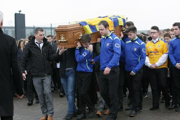The coffin of schoolboy Daryl Comac is carried to Carland Road Cemetery in Dungannon yesterday