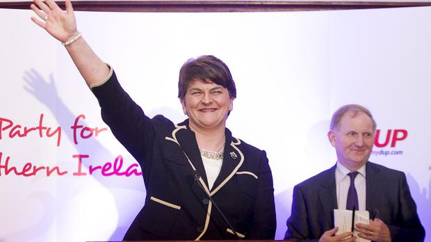 Stormont Finance Minister Arlene Foster waves to DUP supporters after she was elected leader