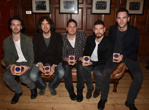 Snow Patrol - from left, Nathan Connolly, Gary Lightbody, Jonny Quinn, Paul Wilson and Johnny McDaid - were presented with medals by Trinity