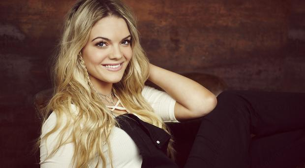 X Factor winner Louisa Johnson faces a challenge for the Christmas number one from the Lewisham and Greenwich NHS Choir (Syco/Thames TV/PA)