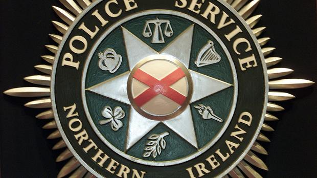Police were in the Heath Lodge Close area of Belfast when a man shot at police car