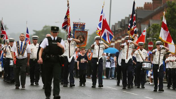 An Orange Order parade on Crumlin Road