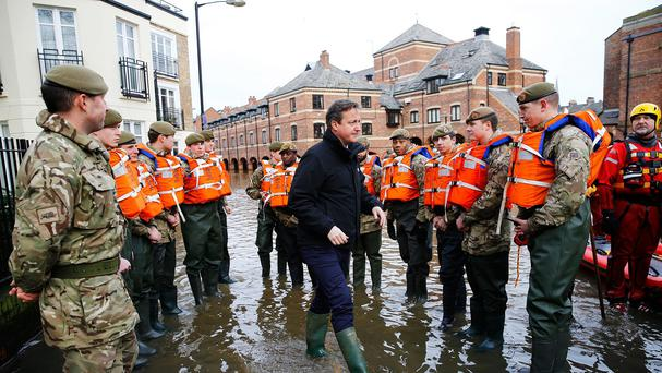 Prime Minister David Cameron greets soldiers working on flood relief in York city centre after the river Ouse burst its banks