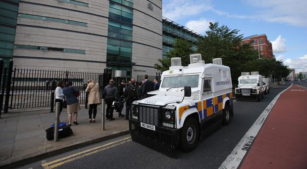 A man is due to appear at Belfast Magistrates' Court after shots were fired at a police car on Christmas Day