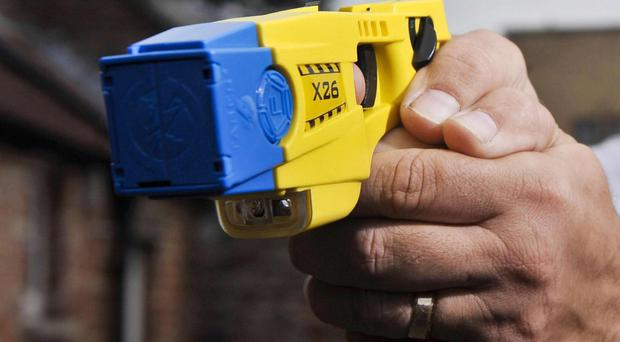 May 27, 2015: Stun gun used by police on woman who was holding a knife against her own throat