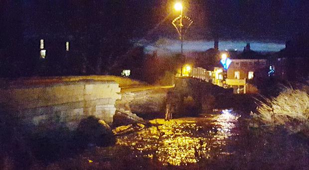 Tadcaster Bridge near York collapses following recent flooding.