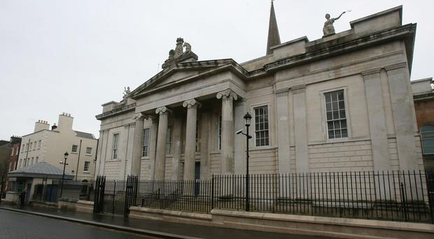 The 22-year-old climbed two security fences in the grounds of Derry courthouse