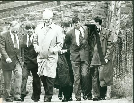 Convivial meeting: Douglas Hurd (in glasses) after a meeting with then-Tanaiste Dick Spring. Mr Hurd was reportedly mortified after having to be walked around a park after drinking with Dublin officials