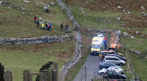 The casualty is brought from Torr Head to a waiting ambulance