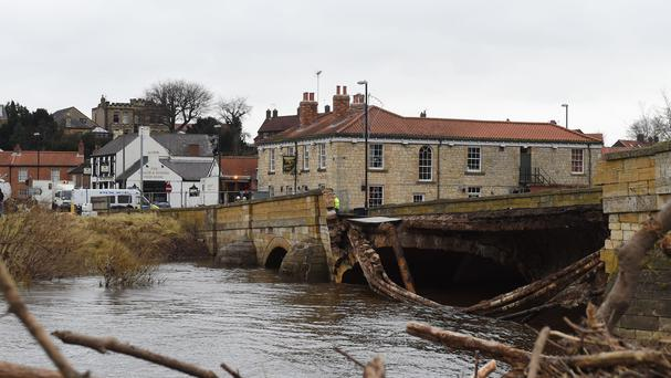 Emergency services by Tadcaster Bridge in North Yorkshire, which has collapsed following recent flooding