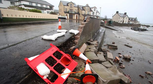 A pier wall in Cushendall lies in ruins after being pummelled by waves during Storm Frank