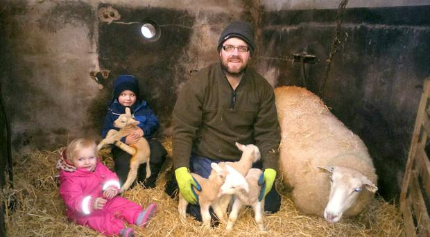 Proud Ballymena farmer Alastair Kerr, his son, Sam (4), and one-year-old daughter Nicole with his home-bred Lleyn-cross ewe that gave birth to four healthy Texel-cross lambs on Tuesday