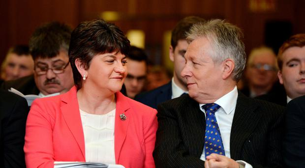 Former DUP leader and First Minister Peter Robinson with his successor, Arlene Foster