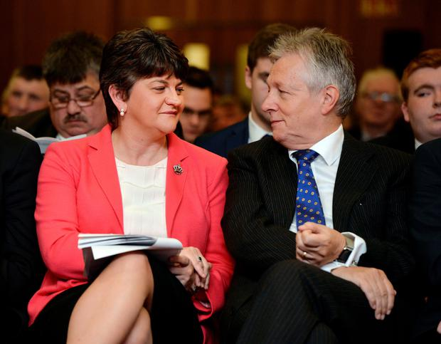 Outgoing DUP leader and First Minister Peter Robinson with his successor, Arlene Foster