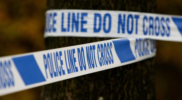 A man armed with a knife has robbed a newsagent in west Belfast