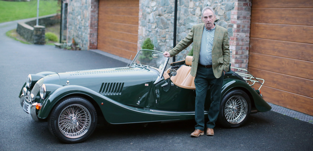 Finnebrogue owner Denis Lynn with his sports car at home in Downpatrick, Co Down
