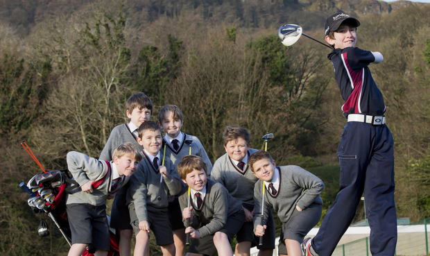 Tom McKibbin demonstrates his golf swing to his class mates